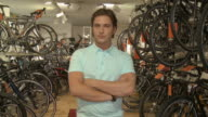 MS, Portrait of young man in bicycle shop, Berlin, Germany