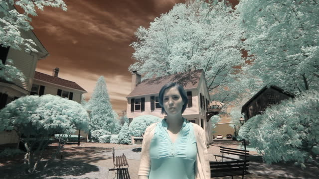 MS Portrait of young woman standing in front of old New England houses, Essex, Connecticut, USA