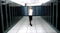 WS Portrait of young woman standing in server room