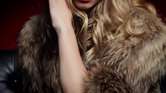 CU SLO MO TU Portrait of young woman wearing fur coat / New York City, USA