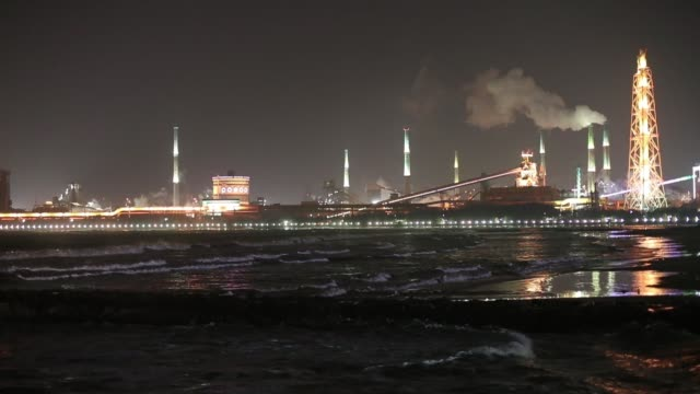 A Posco steel mill is illuminated as it operates at night in Pohang South Korea on Friday Jan 20 An observation deck is illuminated at Yeongildae...