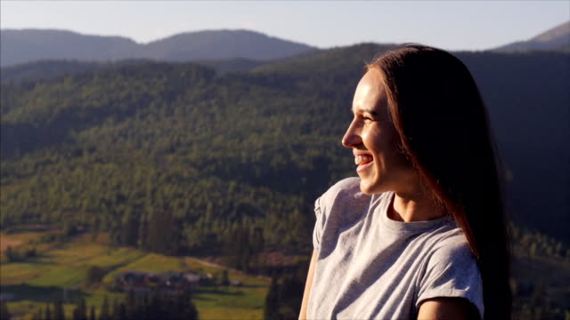 Positive woman enjoying summer vacation at sunset