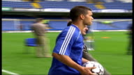 EXT Footballer Michael Ballack onto pitch to meet fans at time of his signing for Chelsea FADE TO TX 28706 Footballer Andriy Shevchenko running on...
