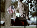 Post box with small US flag