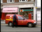 EXT Man into royal mail van outside post office