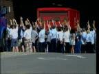 Postal strike ends BONG Group of striking postal workers raising hands to vote