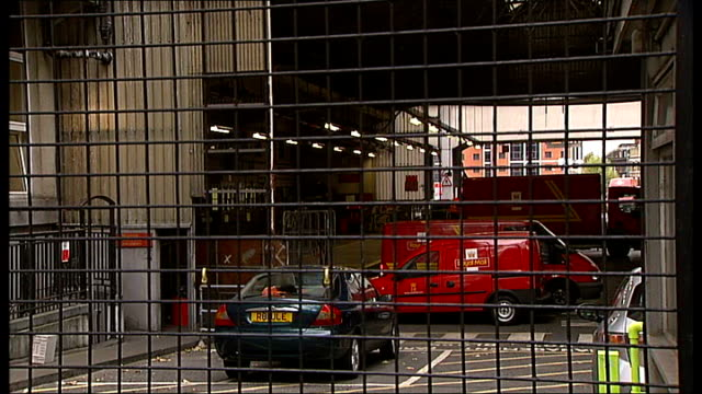 Postal workers' dispute managers expected to provide cover for striking workers EXT Royal Mail building View through wire fence showing Royal Mail...
