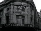 Posters and billboards on the exterior of the Ambassadors Theatre celebrate the record five year run of Agatha Christie's play the Mousetrap