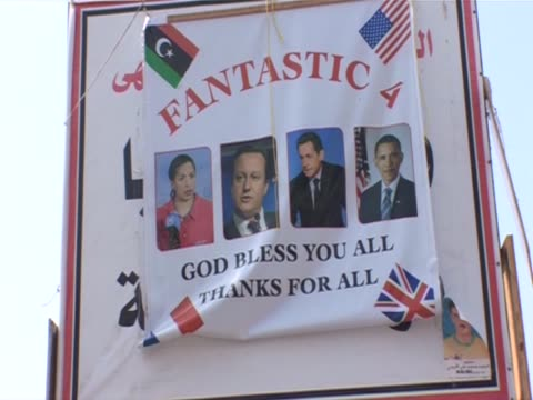 Posters with pictures of Susan Rice David Cameron Nicolas Sarkozy and Barack Obama are displayed in Benghazi's main square Libya September 2011