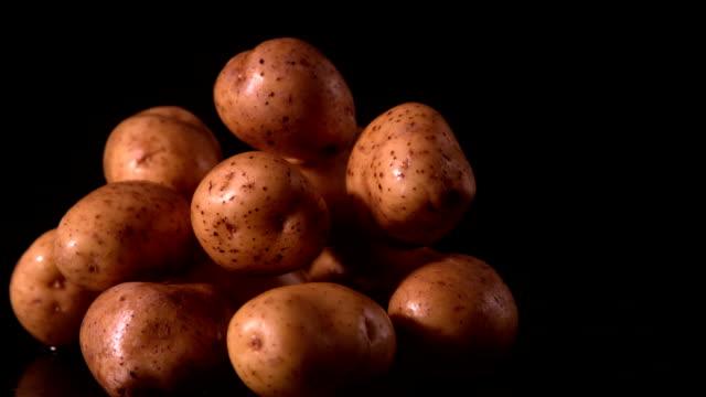 Potato falling on pile of potatoes