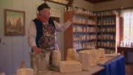 Potter demonstrating how he makes vases