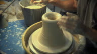 CU TU Potter shaping pot from lump of clay at pottery studio / Windsor, Vermont, USA