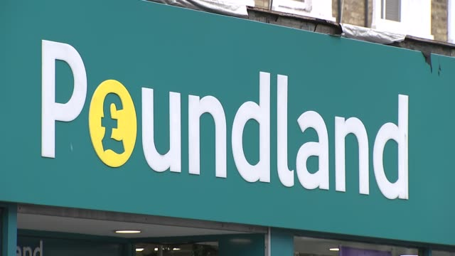 London Seven Sisters Road EXT GVs Poundland store / pedestrians along road / close shot old one pound coin