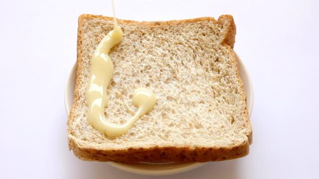 Pour milk into bread