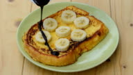 Pour the chocolate on French Toast with Banana, Apple and Orange