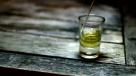 Pouring a drink (whiskey or tequila)