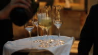 Pouring champagne flutes