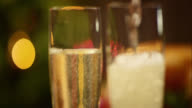 SLO MO of pouring champagne glasses on festive table
