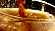 Pouring cola soda