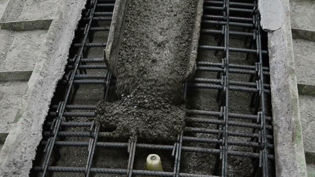 Pouring concrete into the iron mold