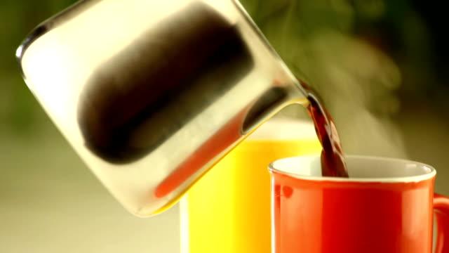 Pouring fresh black coffee