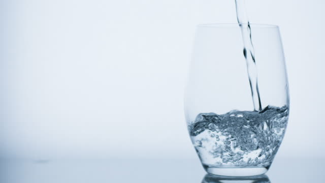 Pouring glass of water. Real video.
