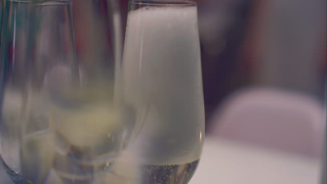 Pouring in sparkling wine