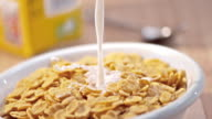 SLO MO Pouring milk over a bowl of corn flakes