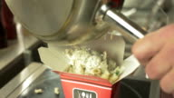 Pouring Pasta in a Take Out Box