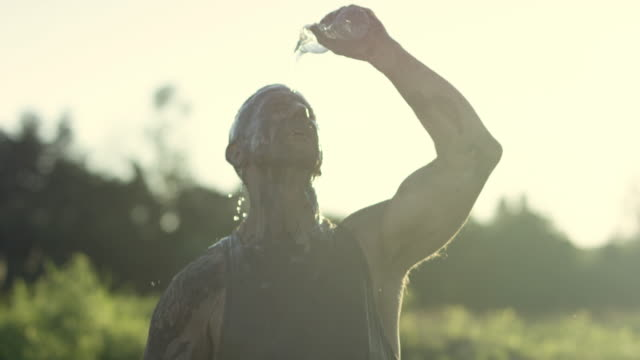 Pouring Water on Himself