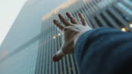 Pov hand reach for high buildings in New York City