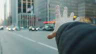 Pov male hand arm hailing cap taxi New York City