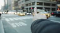 Pov male hand arm hailing cap taxi New York street