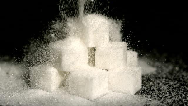 Powdered sugar falling onto cubes
