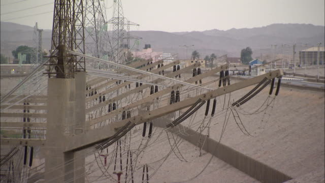 Power lines stand in the Aswan High Dam Power Plant.\n Available in HD.