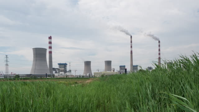 power plant and grassland in Dongying in cloudy sky, timelapse 4k