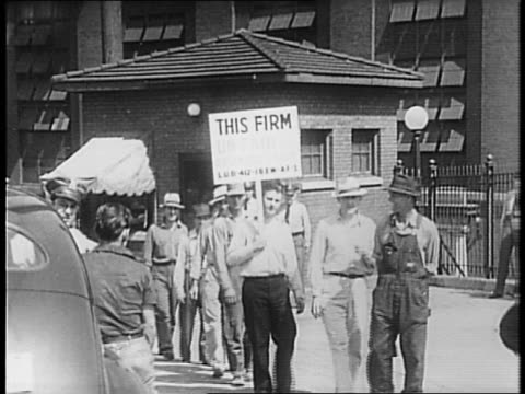 Power plant / strikers picket man holds sign reads 'this firm unfair to organized labor' / Kansas State Guardsman lined up walk off / inactive...