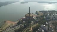 A power station faces a river in Porto Alegre, Brazil.