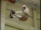 Power suit ENGLAND LAGV Power station TILT DOWN to Les Ward in new protective suit CMS Les Ward in suit LAMS Les suspended on seat in air LS Ditto...