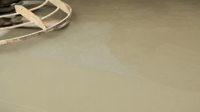 Power Trowel Smoothing Concrete Floor