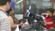 WGN Powerball Hits $425 Million People Buying Powerball Tickets on August 06 2013 in Chicago Illinois