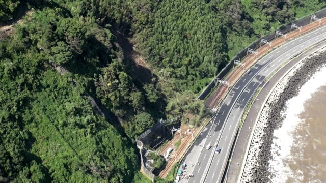 A powerful typhoon hit the Tokyo metropolitan area Monday October 6 after mudslides paralyzed railway services in Shizuoka west of Tokyo The typhoon...