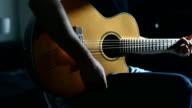 Practicing acoustic guitar