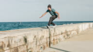 Practicing parkour next to the sea