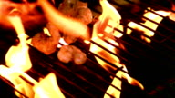 Prawns being cooked on flaming barbecue