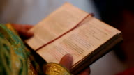 Prayer book in hands of the priest