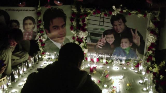 A prayer service and candlelit vigil is held in honour of Sardar Ahmad an AFP reporter killed along with his wife and two children in an attack on a...