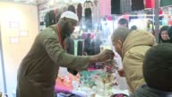 Prayers conferences and especially shopping tens of thousands of Moslems have been flocking since Friday to Frances annual Moslem fair at Le Bourget...