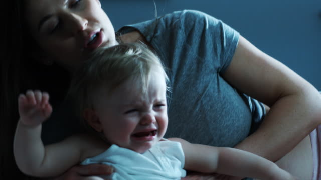 pregnant mother with crying daughter