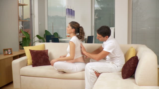 HD DOLLY: Pregnant Woman Getting A Massage
